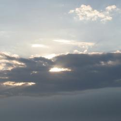 sun peeping through clouds